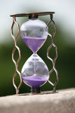 Hourglass counting down the time remaining Stock Photo