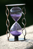 Hourglass counting down the time remaining. The hourglass counting down the time remaining Stock Images