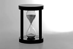 Hourglass counting the time. Time is running out Royalty Free Stock Photo