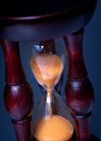 Hourglass on dark background Royalty Free Stock Image