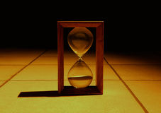 Hourglass in the dark Royalty Free Stock Images