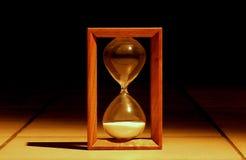 Hourglass in the dark Stock Photo