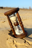 Hourglass in desert Stock Photo