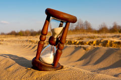 Hourglass in desert Royalty Free Stock Photos