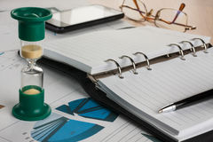Hourglass, diary, pen, glasses and phone Stock Photography