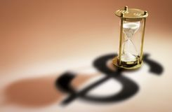 Hourglass and Dollar Symbol. On Warm Background royalty free stock image