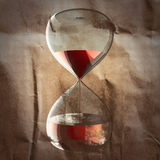 Hourglass with dripping liquid painted on paper Stock Images