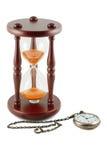 Hourglass e um relógio de bolso imagem de stock