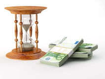 Hourglass with euro Stock Images