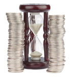 Hourglass and Euro coins Stock Photos