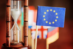 Hourglass and flag of the European Union. Time is running out Stock Images