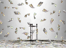 Hourglass and flying dollar bills Stock Photography