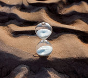 Hourglass on the frozen sand Stock Photos