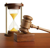 Hourglass and gavel Stock Photo