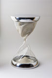 Hourglass glass and steel Stock Photography