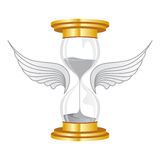 Time flies. Hourglass golden flies with wings Stock Photography
