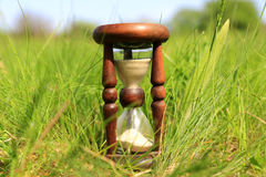 Hourglass in grass Royalty Free Stock Photo