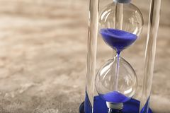 Hourglass on gray background. Time management concept stock images