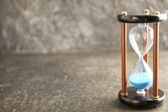Hourglass on grey background. Time management concept stock image