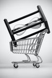 Hourglass in grocery cart Royalty Free Stock Images