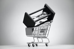 Hourglass in grocery cart Stock Photos
