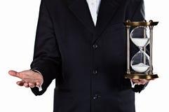 Hourglass in hand Stock Photo
