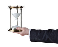 Hourglass in hand royalty free stock photos