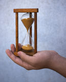 Hourglass. On hand antique countdown instrument time Stock Image