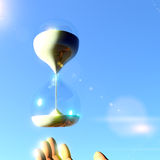 Hourglass and hand Royalty Free Stock Image