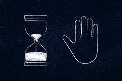 Hourglass and hand making a stop gesture Stock Photos