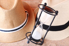 Hourglass with hats Royalty Free Stock Photography