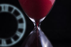 Hourglass with hologram's clock Stock Photos