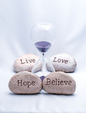Hourglass Hope, Believe, Live and Love Stock Images