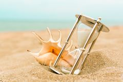 Hourglass. Past timer background sand beach watch Stock Image