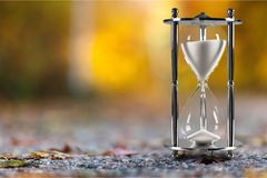 Hourglass. Time clock sand up action ancient Stock Images