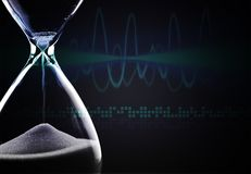 Hourglass. Time shape glass sand falling moving past Stock Photography