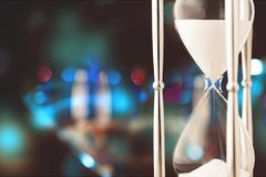 Hourglass. Time shape glass sand falling moving past Stock Photo