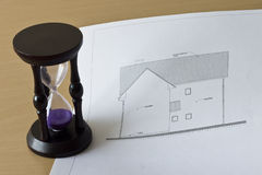 Hourglass and house project Stock Image