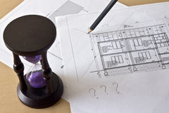Hourglass and house project Royalty Free Stock Images