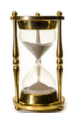 Hourglass Isolated. Gold hourglass isolated on white background Royalty Free Stock Images