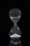 Hourglass isolated on black Royalty Free Stock Photos
