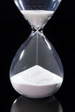 Hourglass isolated on black. Hourglass - sands of time falling down Stock Photos