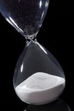 Hourglass isolated on black Stock Photos