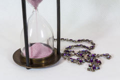 Hourglass and jewelry Royalty Free Stock Photography