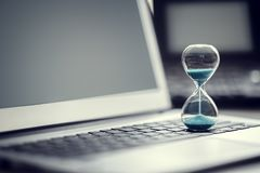 Hourglass on laptop computer concept for time management Royalty Free Stock Photography