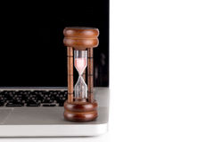 Hourglass with laptop Stock Photo