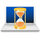 Hourglass on laptop. Time icon. Stock Images