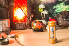 Hourglass in light lanterns Royalty Free Stock Photography