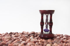 Hourglass on little red stones Royalty Free Stock Photography