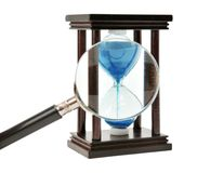 Hourglass and loupe Stock Image